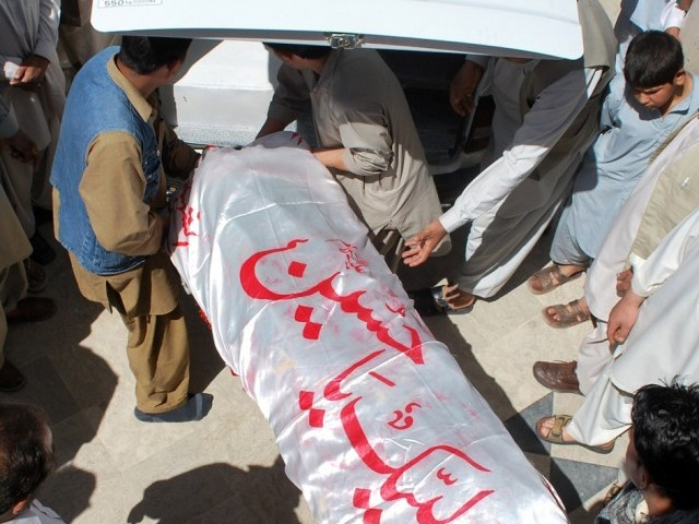 ShiA Muslim men place a coffin of a victim into an ambulance after his funeral ceremony in Quetta on April 10, 2012.  PHOTO: AFP
