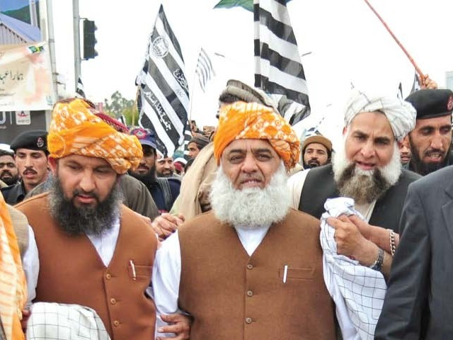 Everyone is trying JUI chief Maulana Fazlur Rehman to end his boycott and attend the PCNS meetings, but to no avail. PHOTO: AFP/FILE