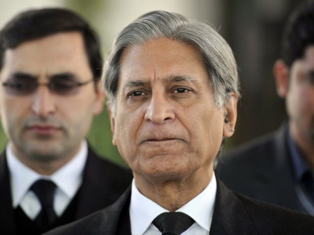 Aitzaz advises the court not to stress much upon presenting premier, president before international magistrate. PHOTO: AFP