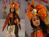 Model walks on ramp on 2nd day of Islamabad Fashion Week 2012 at Pak-China Friendship Centre on Wednesday. PHOTO: Express Tribune/Muhammad Javaid