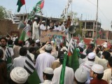 Local leaders of Difa-e-Pakistan Council address a protest against the resumption of Nato supplies outside the Peshawar Press Club. PHOTO: MUHAMMAD IQBAL/EXPRESS