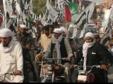 DPC activists organised a bike rally against the decision to reopen Nato supplies on Friday. PHOTO: MUHAMMAD IQBAL/EXPRESS