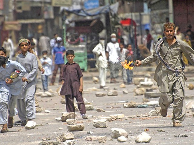 Fear engulfs different areas of Karachi due to aerial firing by unidentified men. PHOTO: RASHID AJMERI/EXPRESS