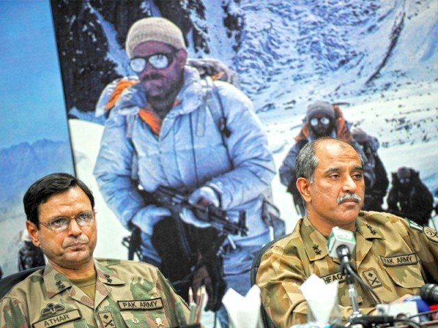 Military spokesman Maj Gen Athar Abbas and Chief of military operations Maj Gen Ashfaq Nadeem speak in a press conference in Rawalpindi. PHOTO: AFP