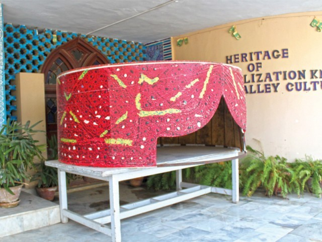 A cardboard Sindhi top is kept outside the museum to keep the Sindhi spirit alive. The blue kashi tiles can also be found at the museum. The Pakka Qila [pictured left] is a big tourist spot. PHOTO: EXPRESS