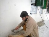Artisan busy at work making wooden skies.