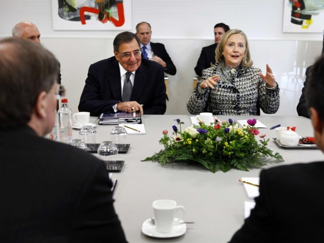 US Defense Secretary Leon Panetta (L) and US Secretary of State Hillary Rodham Clinton speak with Nato Secretary General Anders Fogh Rasmussen (front R) during a meeting at the Nato Headquarters in Brussels, Belgium, April 18, 2012. PHOTO: REUTERS