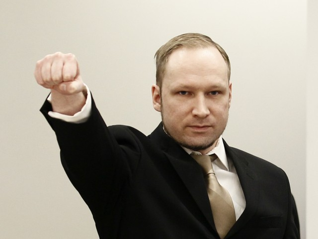 Anders Behring Breivik clenches his fist as he arrives to courtroom for the first day of his trial  in Oslo, April 16, 2012. The terrorism and murder trial against Norwegian mass killer Anders Behring Breivik, who has confessed to the bomb and shooting attacks that killed 77 people in Norway in July 2011, began in Oslo on Monday. PHOTO: AFP
