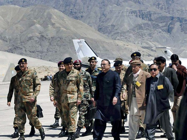 President Asif Ali Zardari arrives at the Skardu airport for his visit to Giari along with Chief of Army Staff General Ashfaq Pervez Kayani. PHOTO: APP