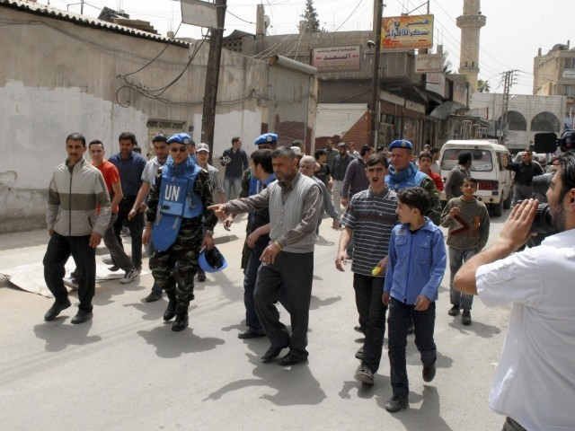U.N. monitoring team visiting a  location of protests against Syrian President Bashar al-Assad. PHOTO: REUTERS