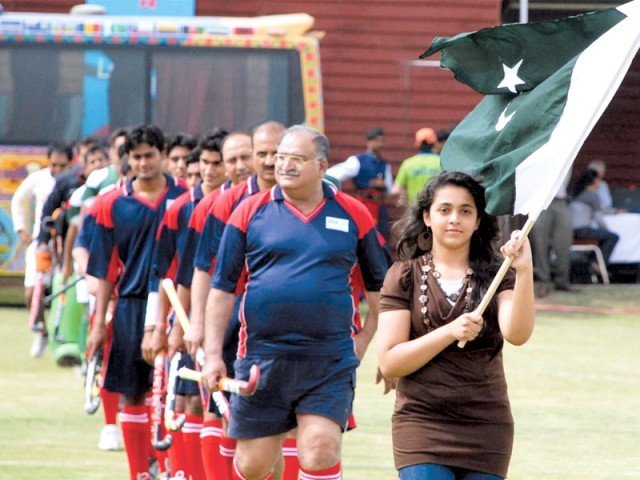 The hockey team was led onto the field by Zainab Imran from Karachi who has been selected to be an Olympic torch bearer. PHOTO: INP