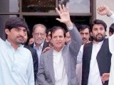 President Pakistan Tehrik-e-Insaf (PTI) Makhdoom Javed Hashmi waves to supporters outside Quetta airport. PHOTO: INP