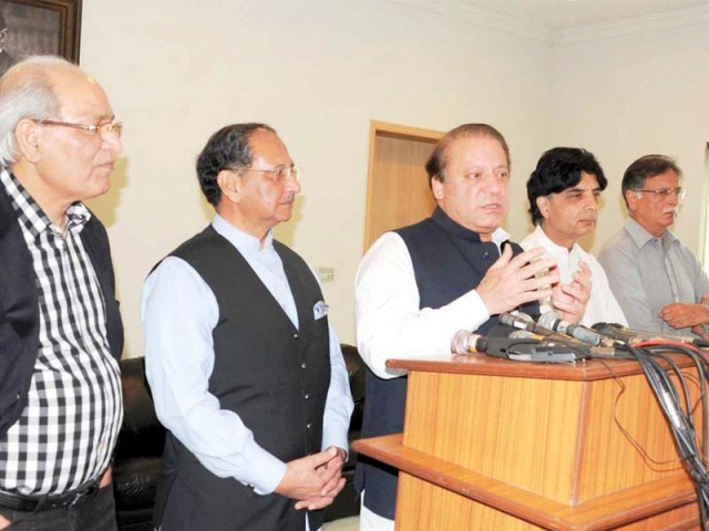 PML-N chief Nawaz Sharif and former senator of PML-Q Tariq Azim briefing the media. PHOTO: NNI