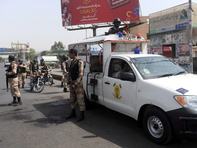 Seven killed in Orangi Town, two in New Sabzi Mandi area, one near Bilawal House. PHOTO: AFP/FILE