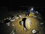 A plane wheel (C) lies amongst debris at the scene of a plane crash as Pakistani rescue workers search for victims in the outskirts of Islamabad on April 20, 2012. PHOTO: AFP