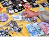 Millions worth of cellphones, jewellery and other luggage items were strewn across the bloodied, burning field. PHOTO: APP