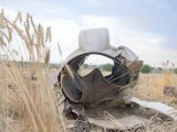 The wrecked engine from Bhoja Air flight B4-213 that crash-landed on a wheat field near Koral Town on Friday evening.  PHOTO : MYRA IQBAL