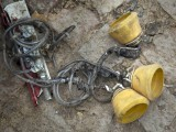 Oxygen masks from Bhoja Air Flight B4-213 are seen among the carnage of the crashed plane in a house in Koral town.  PHOTO : MYRA IQBAL