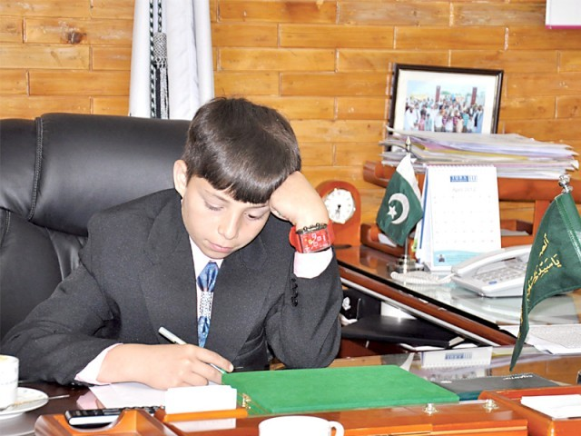 Mohsin sits in the chair of the MD, signing financial documents for the poor and needy patients. PHOTO: THE EXPRESS TRIBUNE