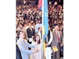 The prime minister hoisting the Book Flag. PHOTO: MYRA IQBAL, APP