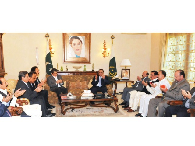 President Asif Ali Zardari prays along with MQM and ANP leaders for the victims of the Bhoja Air plane crash and Siachen tragedy during a meeting at Bilawal House. PHOTO: NNI