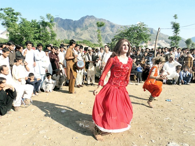 "Dancers perform (top), as players take aim of their targets at the ""Peace Mukha Tournament 2012"" at Jowar Bazaar, Buner on Wednesday. PHOTO: FAZAL KHALIQ/EXPRESS"