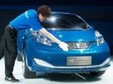 A man cleans a concept electric car by joint Nissan-Dongfeng company Venucia, at the Auto China 2012 car show in Beijing on April 26, 2012. PHOTO: AFP