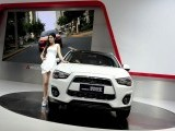 A model poses with a luxury vehicle at the Auto China 2012 exhibition in Beijing on April 26, 2012. PHOTO: AFP