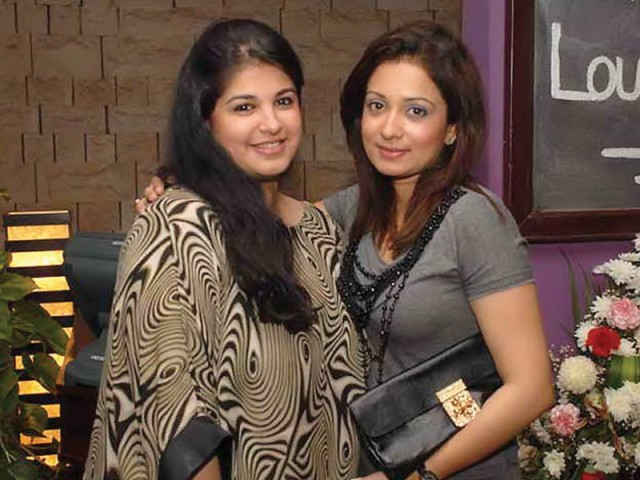 Ms Faiza Savul with her friend