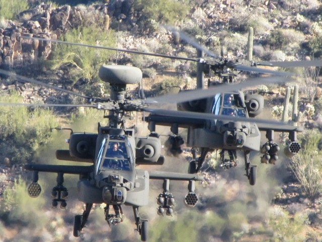 Two Apache attack helicopter gunships on a practice run. PHOTO: US ARMY