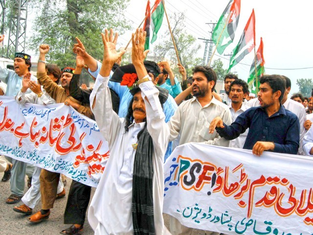 Activists of the PPP shout slogans during a protest in Peshawar against the contempt of court verdict handed to Prime Minister Yousaf Raza Gilani. PHOTO: AFP