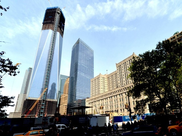 One World Trade Center (L) stands in New York City April 30, 2012. PHOTO: AFP