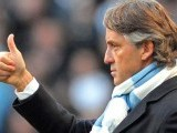 """It is not finished,"" Mancini warned his players after Vincent Kompany's header clinched a famous win. PHOTO: AGENCIES"