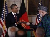u-s-president-obama-and-afghan-president-karzai-exchange-documents-after-signing-the-strategic-partnership-agreement-at-the-presidential-palace-in-kabul