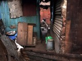 A man listens to the radio amidst a collection of homes built in the style of traditional colonial-era Board Houses dating back about a century in the Congo Town neighbourhood of Sierra Leone's capital Freetown April 27, 2012. Picture taken April 27, 2012. PHOTO: REUTERS