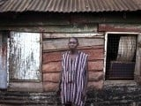 Jacob Thomas, 48, poses for a portrait outside House 7 on Grey Lane in Congo Town, which local residents say was built in 1902, making it the oldest remaining colonial-era Board House in the Congo Town neighbourhood of Sierra Leone's capital Freetown April 28, 2012. Thomas said it was built by his great-grandmother's family after she returned from Britain. She had originally been taken as a slave from her home in Brazzaville, Congo, at that time a French colony, according to the family. Picture taken April 28, 2012. PHOTO: REUTERS