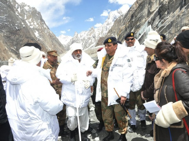 Chief of Army Staff, General Ashfaq Parvez Kayani during his visit to Gayari on Thursday with father of Major Zaka, who came under avalanche on 7 April 2012, talking to journalists. PHOTO: ISPR