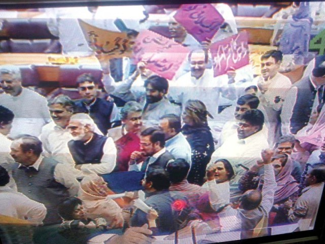 A television screen in the parliament's lobby shows PML-N members protesting during the session. PHOTO: INP