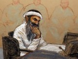Khalid Shaikh Mohammad sits during his arraignment in Guantanamo Bay on May 5. SKETCH: JANET HAMLIN