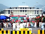 Party workers, leaders making arrangements for march expected to be attended by thousands. PHOTO: QAZI USMAN/EXPRESS
