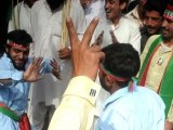 PTI supporters dance at the protest. PHOTO: QAZI USMAN