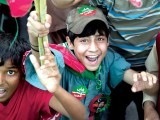 A child chanting slogans (above); an exuberant PTI supporter showing off his dancing skills. PHOTO: MYRA IQBAL