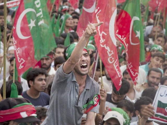 A charged PTI supporter shouts slogans at the rally . PHOTO: MYRA IQBAL/EXPRESS