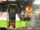 Screenshot of the bus set alight by students.