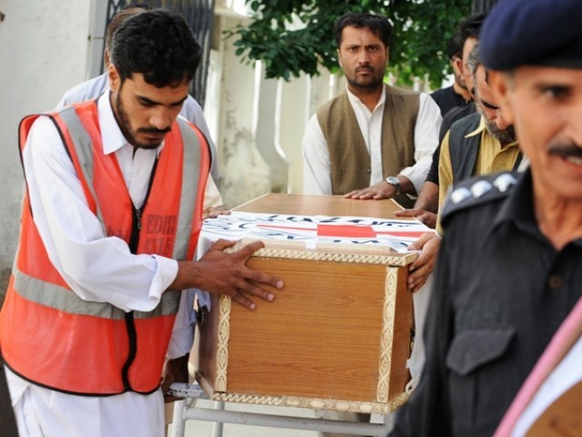 In this photograph taken on April 30, 2012, volunteers carry the coffin of British aid worker Khalil Dale, before handing it over to Red Cross officials in Quetta. PHOTO: AFP/FILE