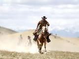 Wrangler Shad Boardman rides into a pasture during Montana Horses' annual horse drive outside Three Forks, Montana, May 6, 2012. PHOTO: REUTERS