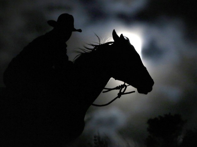 "Wrangler Nate Cummins takes the opportunity to ride by moonlight, the night before the ""Super Moon"" during Montana Horses' annual horse drive outside Three Forks, Montana, May 4, 2012. PHOTO: REUTERS"