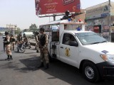 karachi-violence-killing-rangers-police-bus-fire-photo-afp-18-2-2-2-2-2