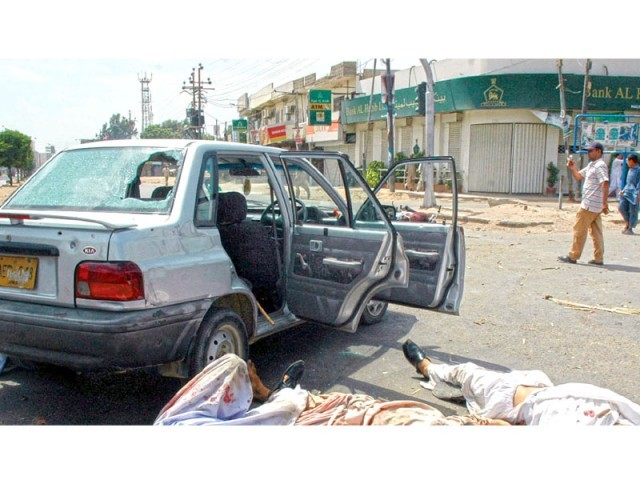 Iqbal is one of the men lying in this photo, presumed to be left for dead, by the armed men at Malir Halt on May 12, 2007. Iqbal was shot six times but miraculously survived. PHOTO: FILE