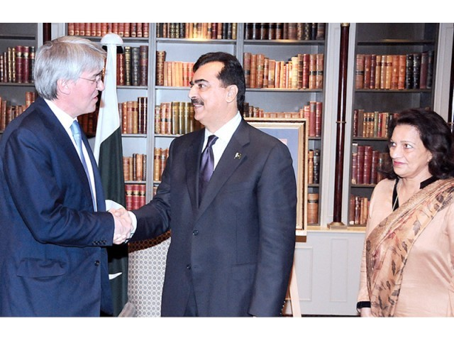 Prime Minister Yousaf Raza Gilani talks to British Secretary DIFD Andrew Mitchell. PHOTO; APP
